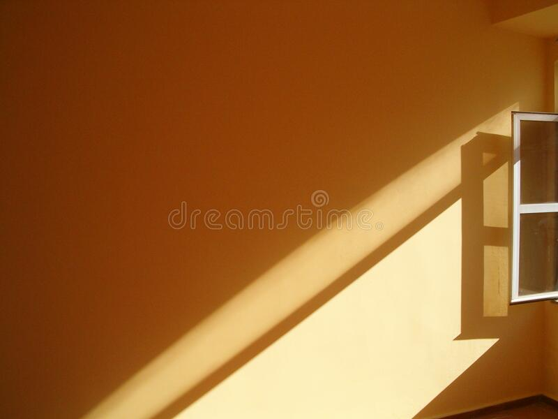 Sunlit window on wall royalty free stock photo