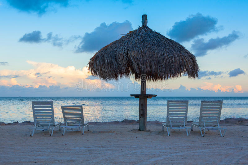 Sunlounge chairs and umbrella on the sunset beach in Florida Key. Sunlounge chairs and umbrella on the sunset beach in Marathon Key, Florida Keys, USA stock images