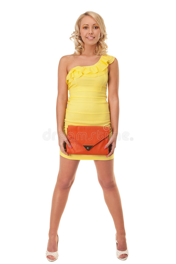 Sunnie blond. Young girl in yellow mini-dress royalty free stock images