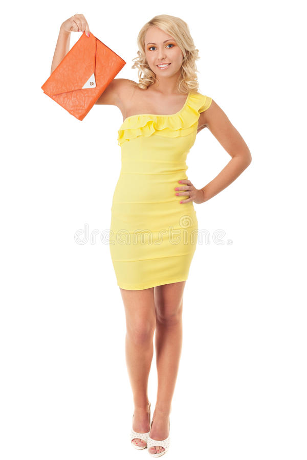 Sunnie blond. Young girl in yellow mini-dress royalty free stock photos
