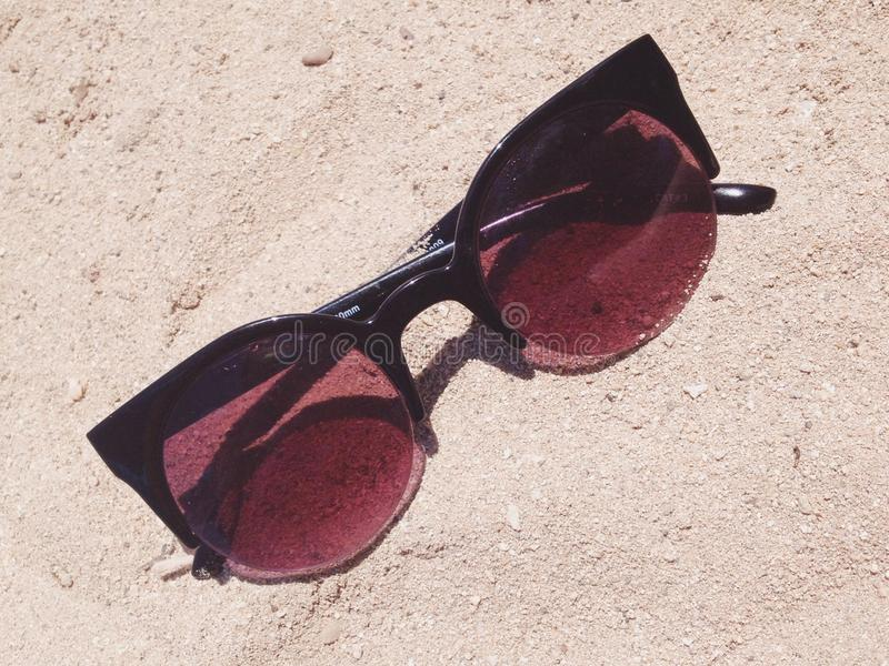 Sunnies. Beach essential: a nice pair of sunnies royalty free stock images