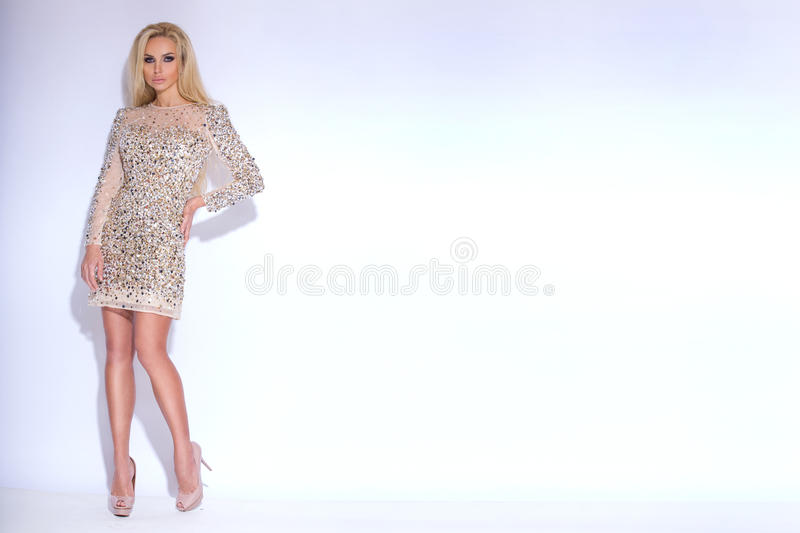 Sunning beautiful young woman blond long hair and of short elegant dress with glowing crystals stock photos