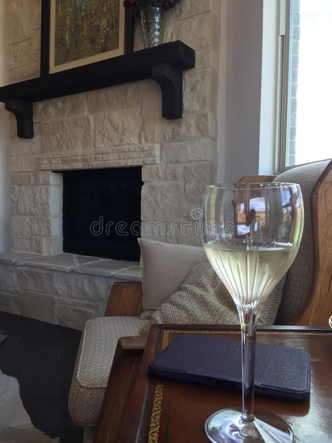 Sunny afternoon wine and a book. Sunny fireplace frosty wine stock photos