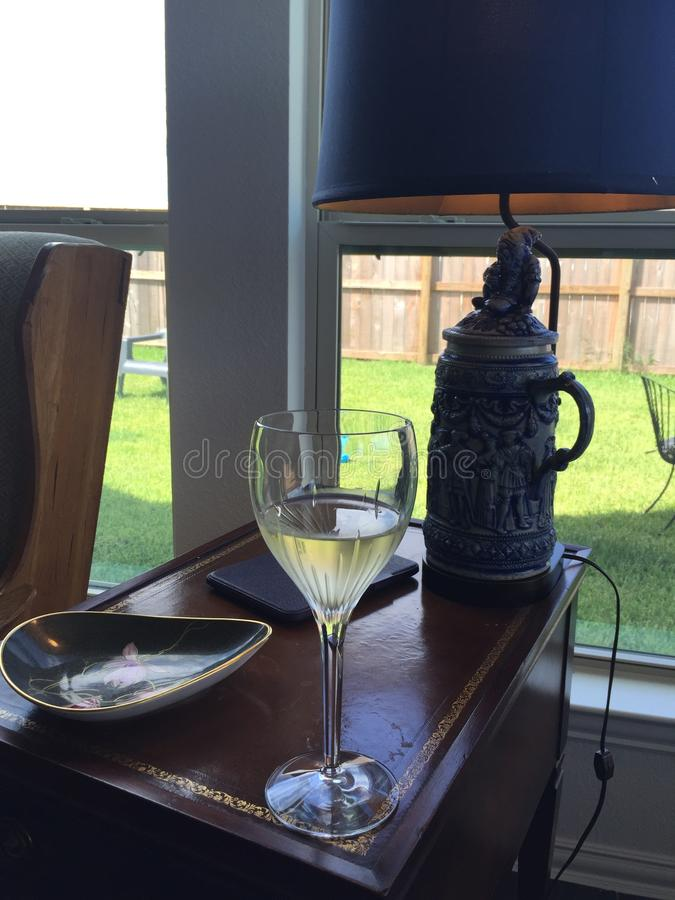 Sunny afternoon wine and a book. Sunny fireplace frosty wine stein royalty free stock images