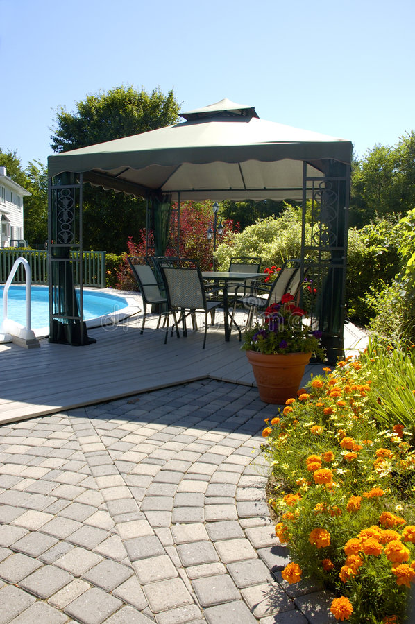 Sunny Backyard. Gazebo In A Sunny Backyard With Swimming Pool