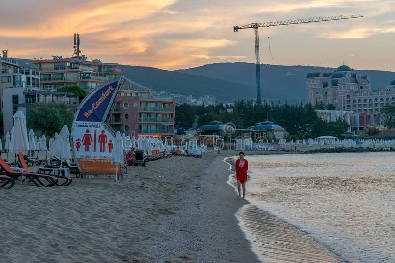SUNNY BEACH, BULGARIA - 2 SEP 2018: Woman walking at beach at sunrise in Sunny Beach resort on a sunny day in Bulgaria s Black Sea stock images