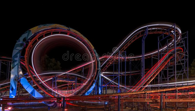 SUNNY BEACH, BULGARIA - September 10, 2017: Attraction in the park. Carousel in motion at night. A long exposure photo stock photo