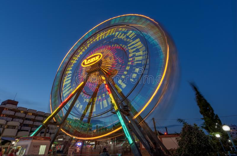 SUNNY BEACH, BULGARIA - September 10, 2017: Attraction in the park. Ferris wheel in motion at night. A long exposure photo stock images