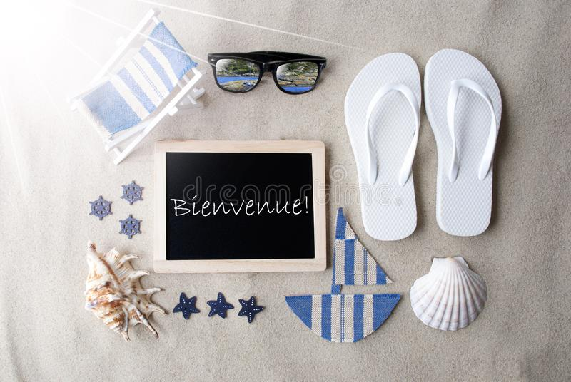 Sunny Blackboard On Sand, Bienvenue Means Welcome stock photos