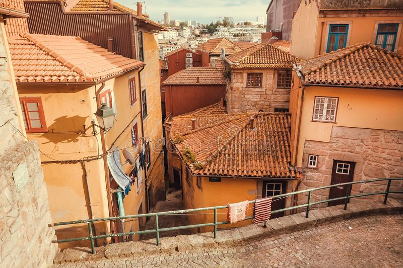 Sunny cityscape with historical houses street and red tile roofs of the big port city. Sunny cityscape with historical houses street and red tile roofs of the stock photo