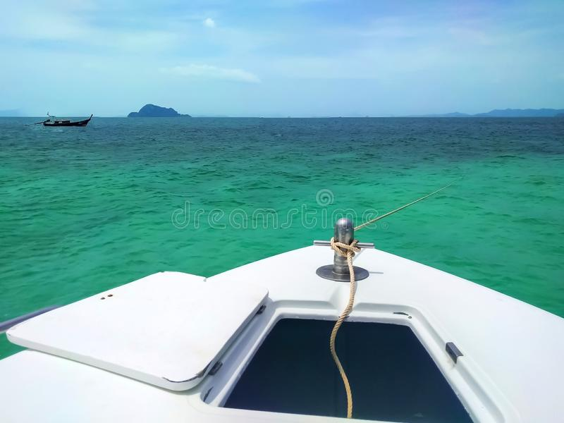 Sunny day at anchor fishing boat in sea, Thailand. Sunny day at anchor fishing boat in sea, Phuket, Thailand stock photo