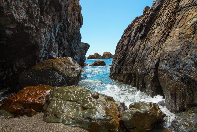 Sunny day beach rock canyon royalty free stock photo