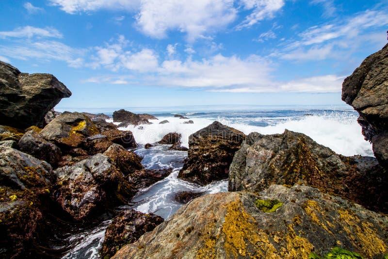 Sunny day beach rock formation royalty free stock photos