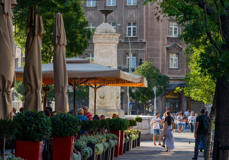 Old fountain in the center of Belgrade with casual passingers stock images
