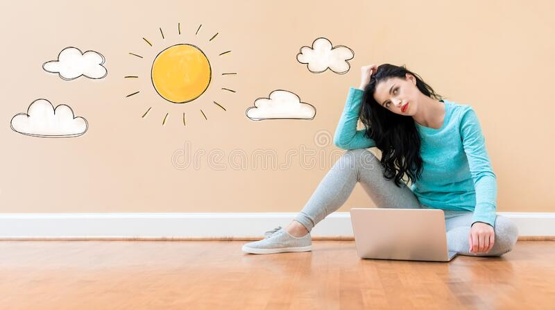 Sunny day concept with woman using a laptop royalty free stock photo