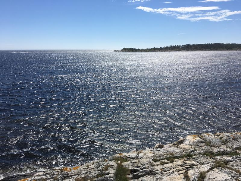 Sunny day on The east coast of Norway. A summer day overlooking The ocean near Valle in Telemark county stock image