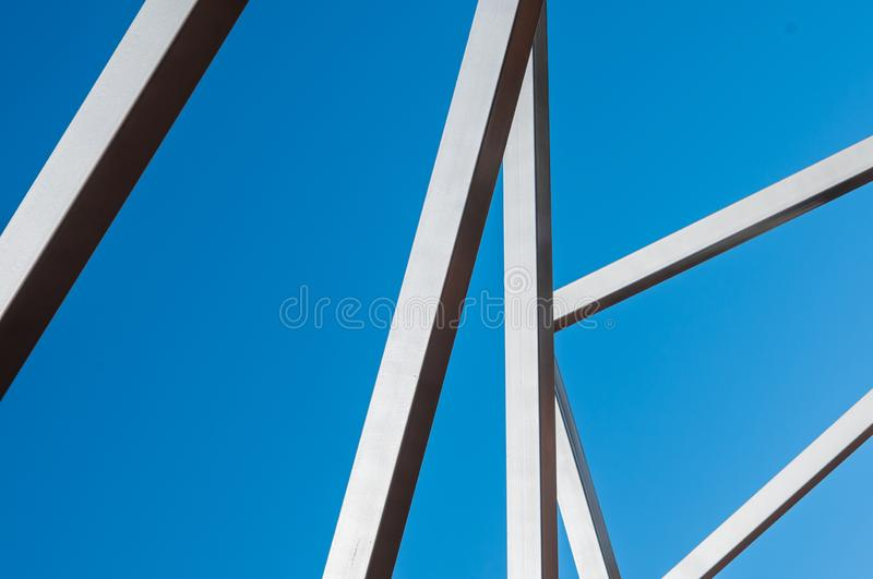 Metal art Line in the park. Sunny day, installation Modern Art, metal arcs in the park, province royalty free stock image