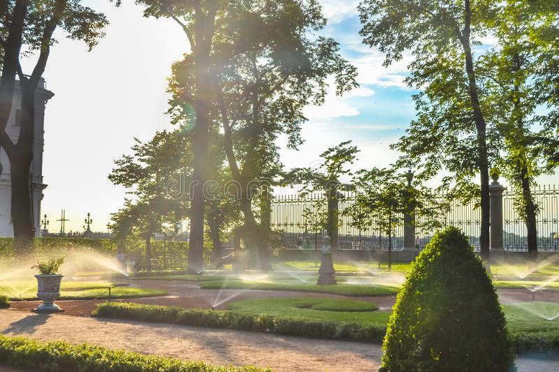 Sunny day and irrigation sprinklers at Summer Garden, St. Petersburg royalty free stock images