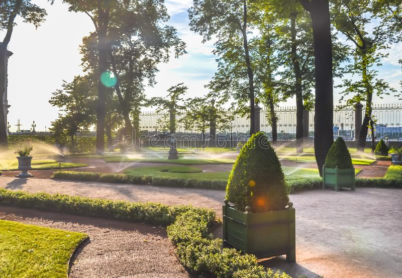 Sunny day and irrigation sprinklers at Summer Garden, St. Petersburg stock photos