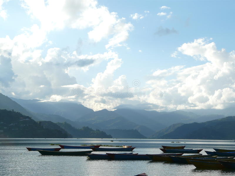 Sunny day in the lake Pokhara, Nepal. royalty free stock image
