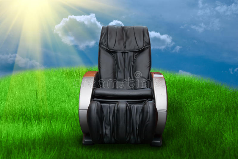 Sunny day with massage arm-chair stock photos