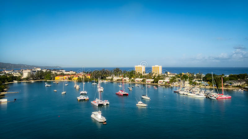 Sunny Day in Montego Bay, Jamaica. Panoramic view of Montego Bay, Jamaica on a stunning spring day featuring boats floating in the emerald waters of the bay royalty free stock photography