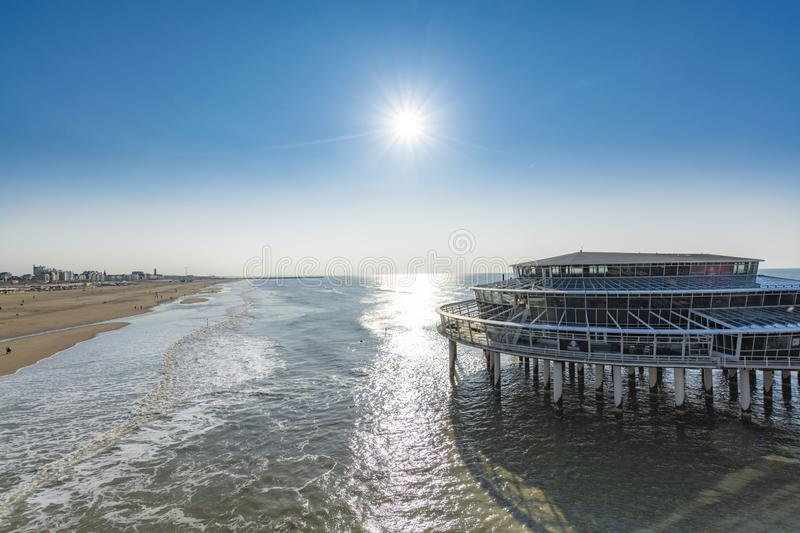 Sunny day on North sea beach in Netherlands in Scheveningen, tourist and vacation destination in Europe. Sunny day on North sea beach in Netherlands in stock images