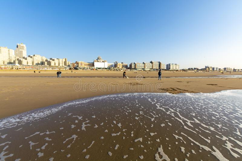 Sunny day on North sea beach in Netherlands in Scheveningen, tourist and vacation destination in Europe. Sunny day on North sea beach in Netherlands in royalty free stock image