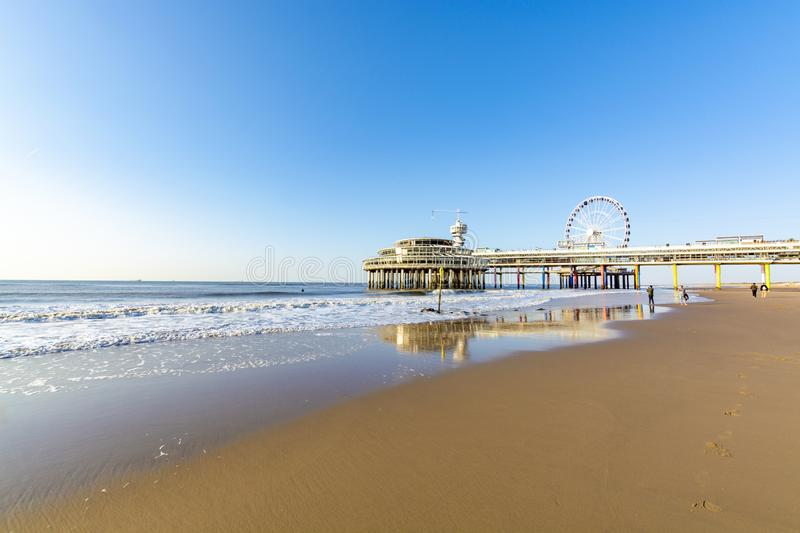Sunny day on North sea beach in Netherlands in Scheveningen, tourist and vacation destination in Europe. Sunny day on North sea beach in Netherlands in stock photography