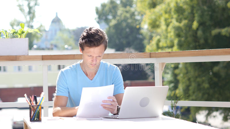 Sunny Day, Paperwork, Reading Details of Start Up Project stock image