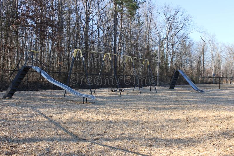 Slide and swings at the park and a feautiful suuny day stock photo