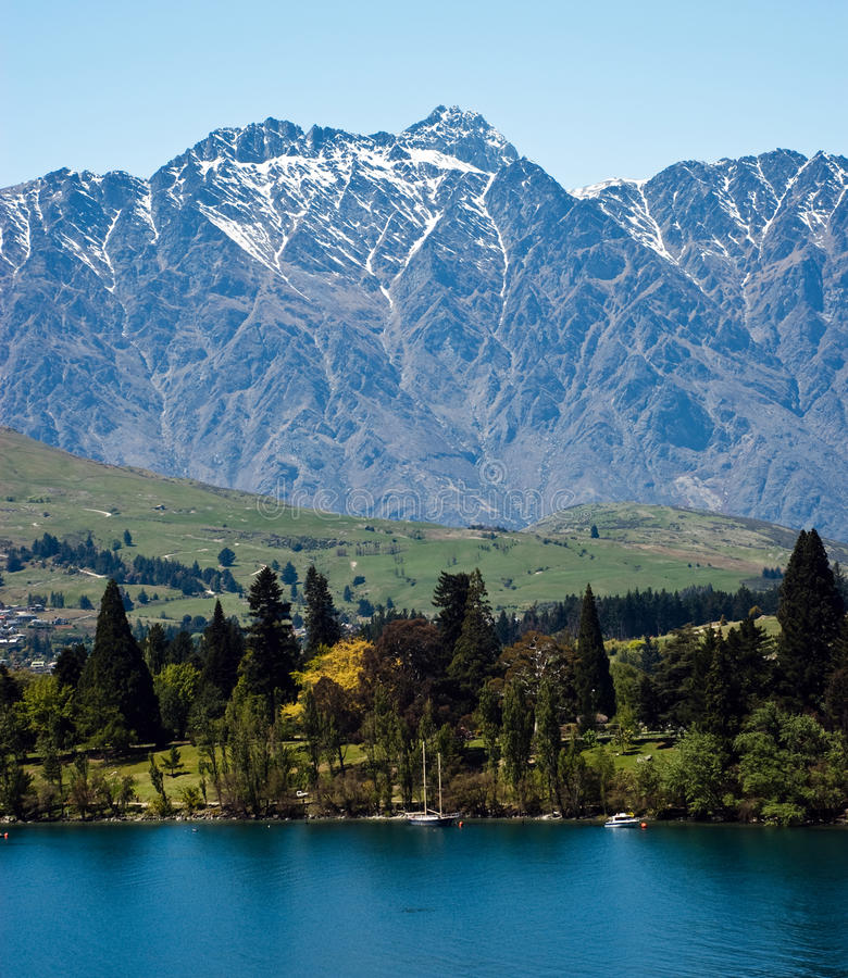 Sunny day in Queenstown. Sunny summer day in Queenstown, New Zealand, with view on lake Wakatipu and Remarkables Mountains stock photos
