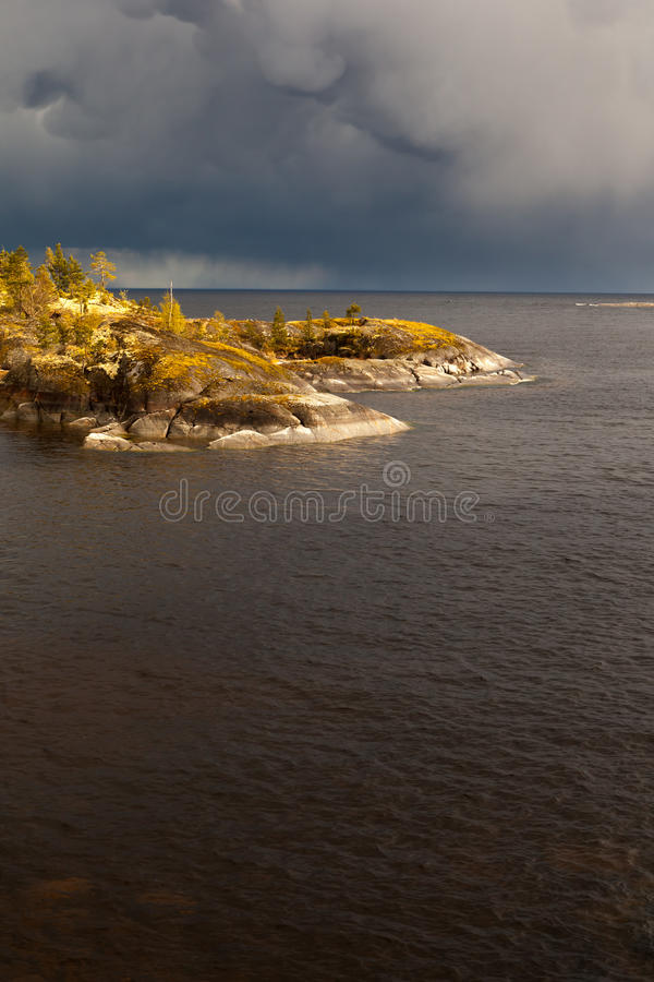 Sunny day on the rocky shore of the lake. stock photography