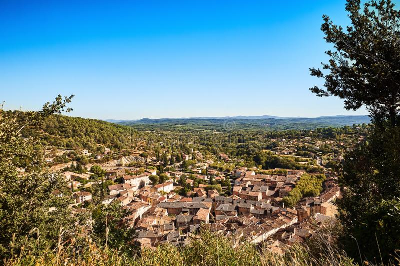 High resolution overview of the beautiful Provencal village Cotignac. A sunny day in the South of France. The image shows an overview of Cotignac and its stock photo
