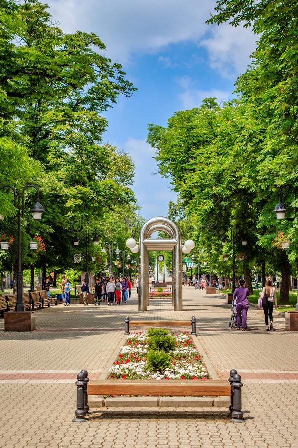 Apatin, Vojvodina, Serbia. A sunny day in spring with, walking school children and others, on a walking promenade in the center of Apatin royalty free stock photography