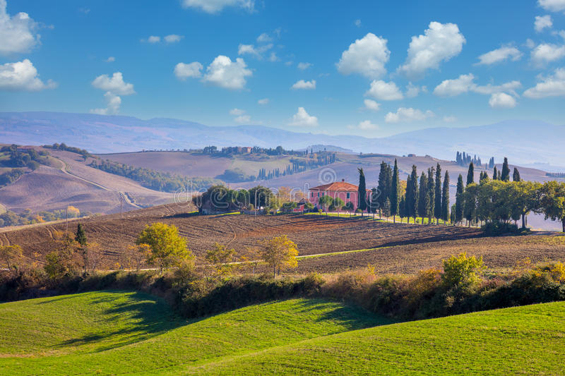Sunny Day Tuscany landscape with beautiful hills. Fields and meadow, spring time stock photos