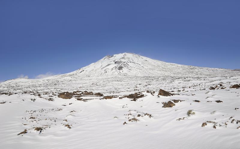 Sunny day with vistas towards Pico Viejo covered in snow in Teide National Park, Tenerife, Canary Islands, Spain royalty free stock photography