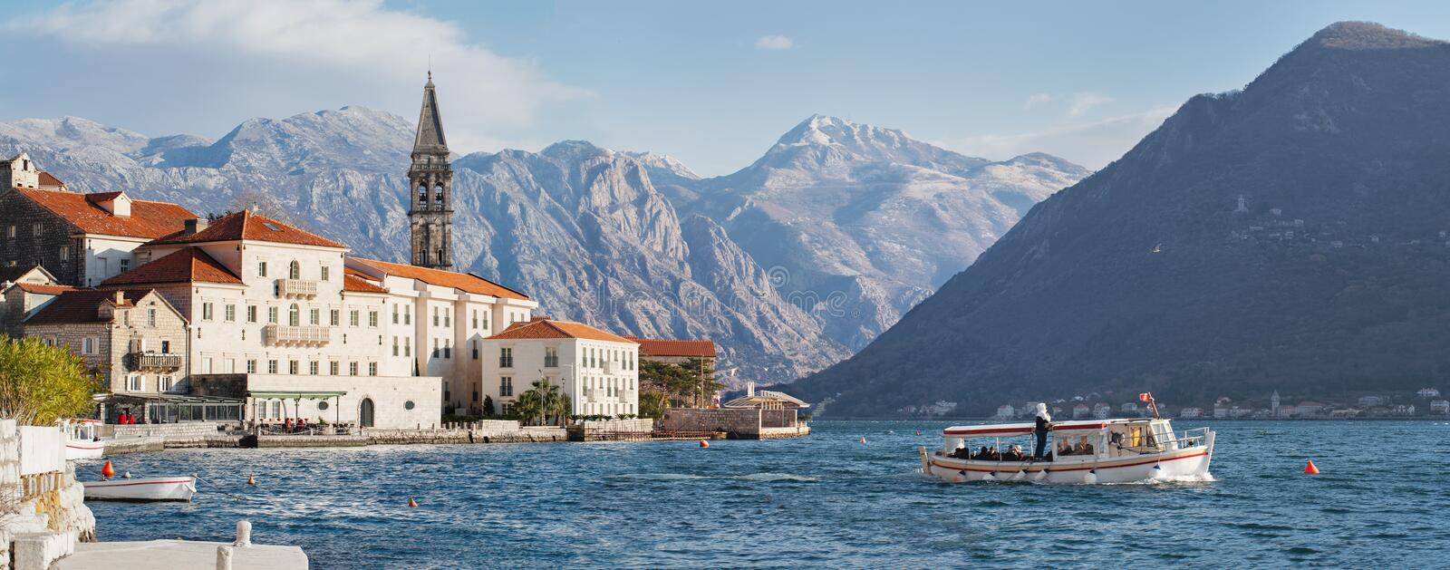 Sunny day on the waterfront in Perast royalty free stock photo