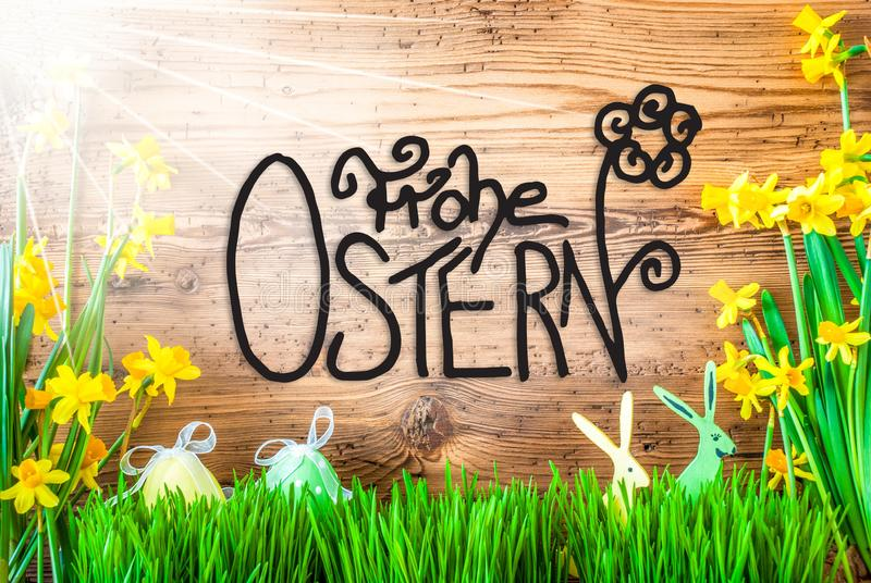 Sunny Easter Decoration, caligrafía Frohe Ostern significa Pascua feliz imagen de archivo