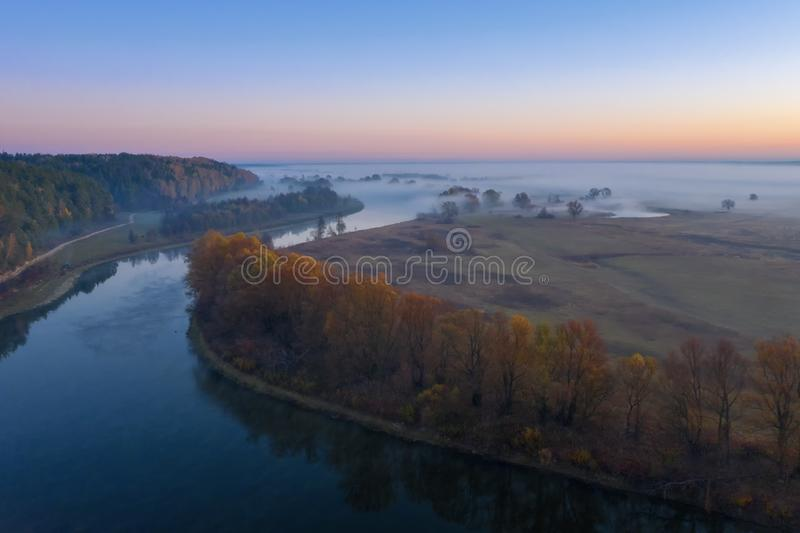 Sunny and foggy morning over the river, fog in the sun. stock photo