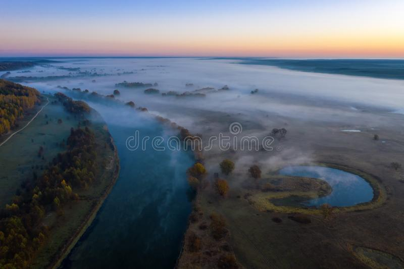 Sunny and foggy morning over the river, fog in the sun. stock photography