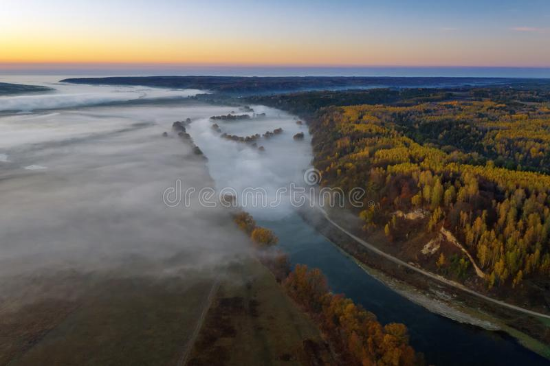Sunny and foggy morning over the river, fog in the sun. royalty free stock photos