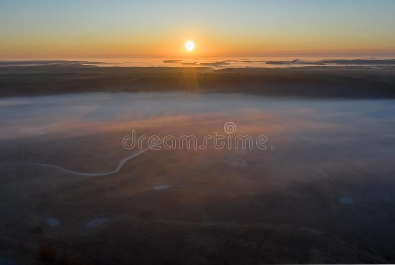Sunny and foggy morning over the river, fog in the sun. royalty free stock photography