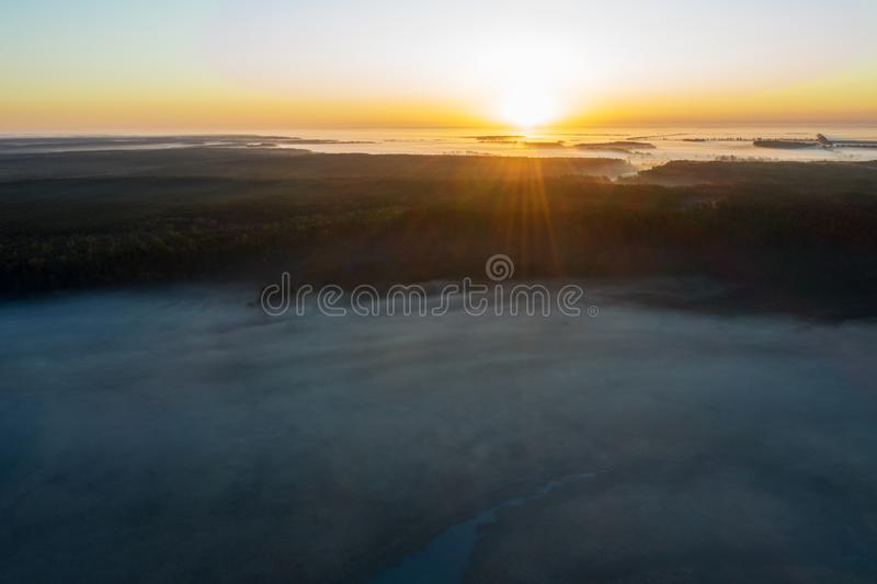 Sunny and foggy morning over the river, fog in the sun. stock images