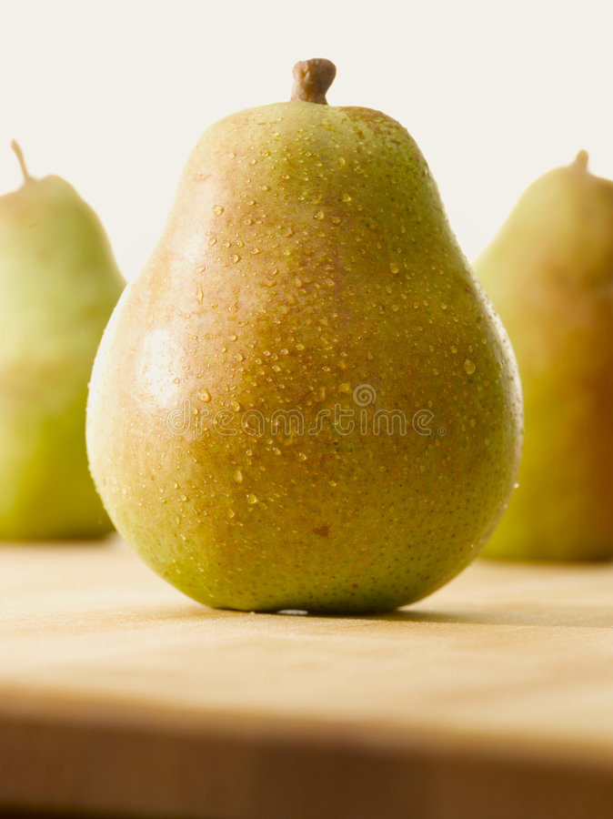 Sunny fresh pear royalty free stock photography