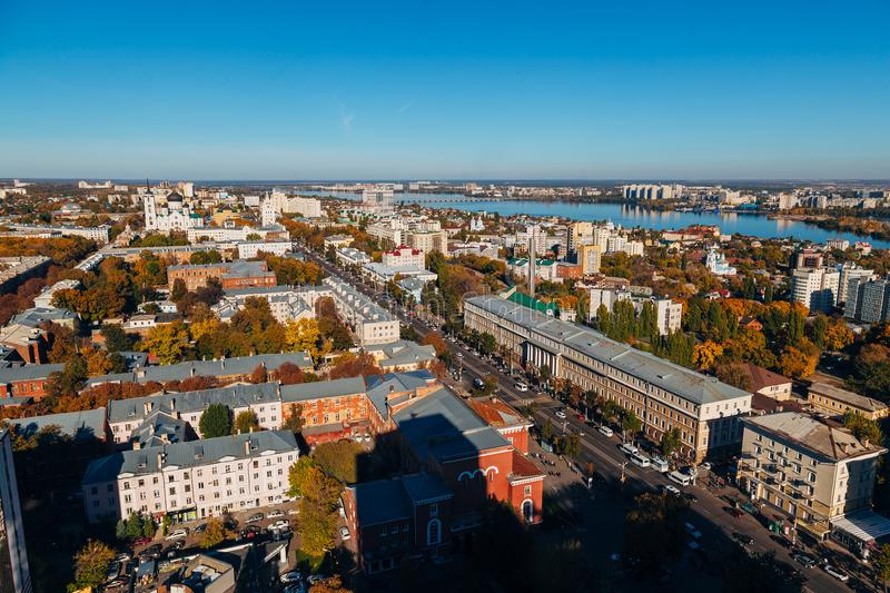 Sunny golden autumn Voronezh. Aerial view from skyscraper roof height to Revolution prospect - central street of Voronezh.  stock photos