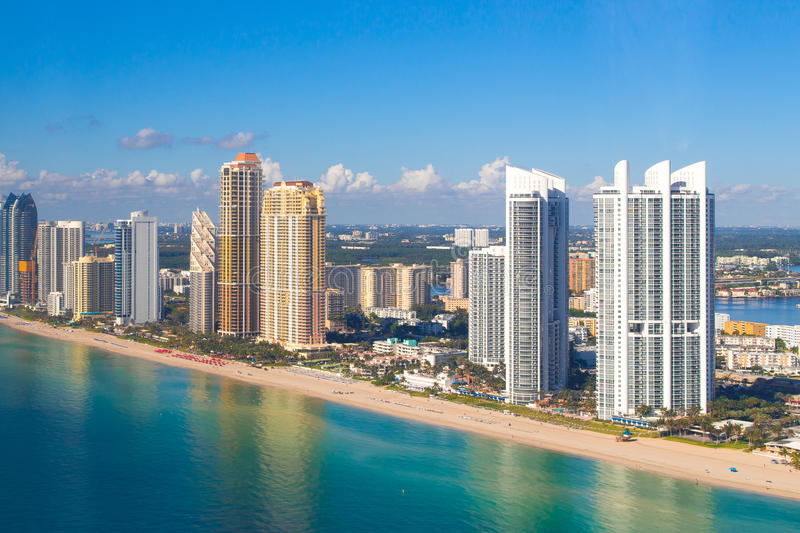 Aerial View of Trump Tower at Sunny Isles Beach. Sunny morning shot of Sunny Isles Beach in South Florida right after sunrise. White Trump Tower on the right stock images
