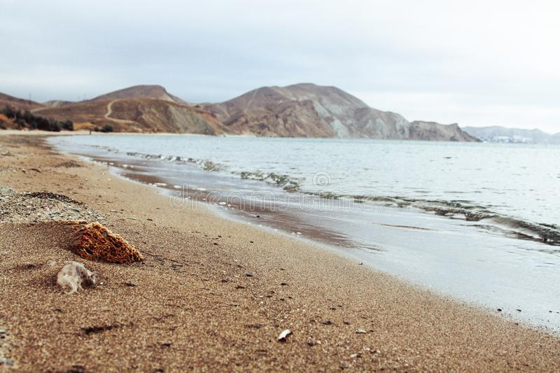 Sunny landscape of seaside shore with view of two stones. Black Sea, Koktebel, Crimea stock photography
