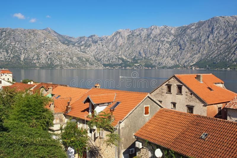 Sunny Mediterranean landscape. Montenegro, Adriatic Sea. View of Bay of Kotor and red roofs of Prcanj town stock photography