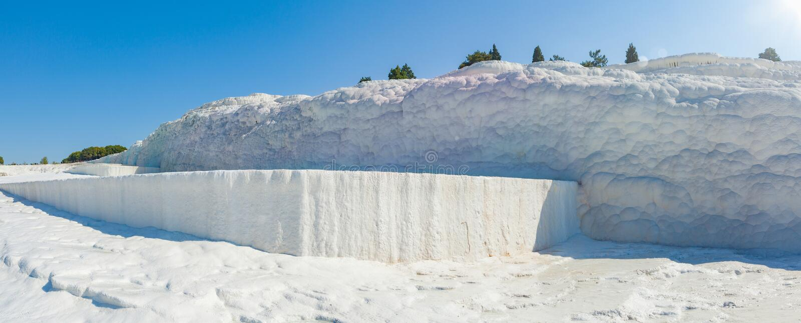 Sunny morning with clear blue sky in Pamukkale. Pamukkale is geological phenomenon, literally `Cotton Castle` in Turkish, most visited attraction in Turkey royalty free stock photos
